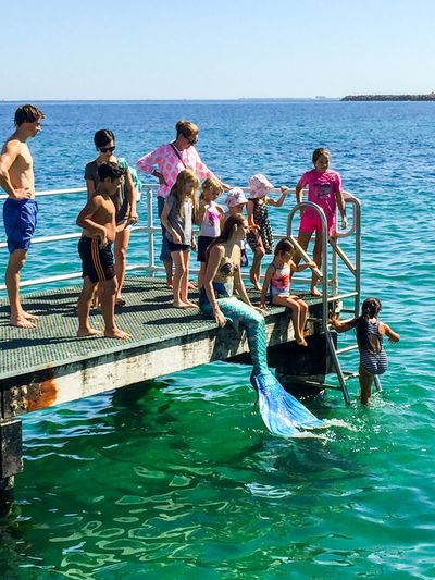 Mermaid on the Jetty People Sea Coogee Beach Festival Indian Ocean Western Australia Event Festival Entertainment April 3,2016 Coogee, WA Mermaid Costumes Performers Interactive  Colorful Tails Interactive Art Performance Art Families Touch And Feel Water Jetty Fun Fantasy Kids