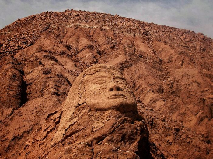 Sculpture Of Face Against Sky