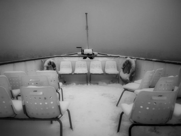 Switzerland Zürich Lake Zürich Black & White Chair Misty Nature Shades Of Winter Tranquility Winter Beauty In Nature Blackandwhite Day Fog Foggy Lake Landscape Mist Mode Of Transport Monochrome No People Outdoors Scenics Ship Sky Tranquil Scene Water