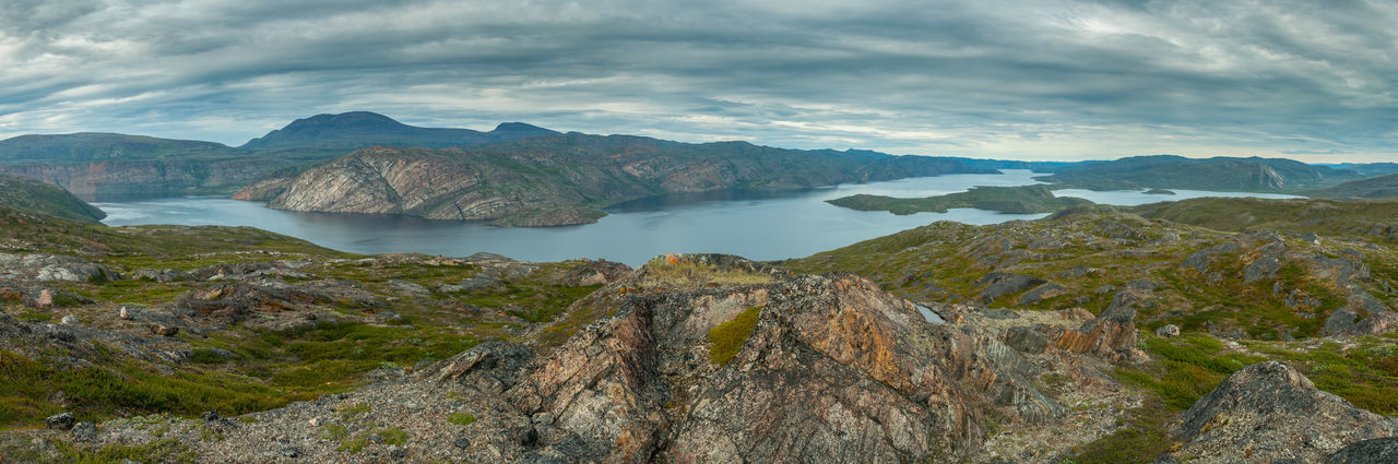 Arctic Circle Trail Beauty In Nature Cliff Cloud - Sky Day Greenland Hiking Hiking Trail Hikingadventures Lake Landscape Mountain Mountain Range Nature No People Outdoor Outdoors Remote Scenics Sky Tranquil Scene Tranquility Travel Destinations Trekking Water