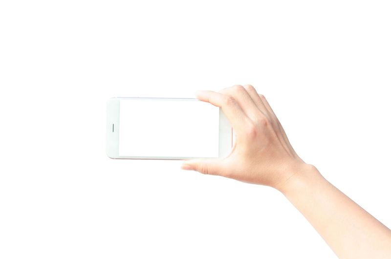 Woman hand holding the black smartphone on white background Isolated Screen; Communication Communication; Connection Empty; Finger Finger; Hand Human Hand Mobile; Mockup; One Person Showing; Smartphone; Technology Technology; Structure; Steel; Machine; Tall; Up; White Background White; Listen; Background; Music; Musical; Gadget; Black; Headset; Modern; Audio; Isolated; Top View; Sound; Cable; Plastic; Earbud; Technology; Equipment; Headphone; Entertainment; Mobile; Earphone; Volume; Device; Electronics; Relaxation Wireless Technology Woman;s Shoes
