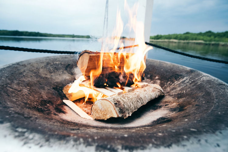 Bonfire Burning Close-up Day Fire Fire Pit Flame Food Heat - Temperature Lake Motion Nature No People Outdoors Sky Water Wood