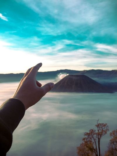 Good morning Bromo Mountain Mount Bromo Bromo-tengger-semeru National Park EyeEm Nature Lover Indonesia_allshots Indonesia_photography Indonesia Scenery Hikingadventures Nature Body Part Beauty In Nature Mountain Leisure Activity Finger Human Finger Water Tranquil Scene Outdoors Lifestyles Day