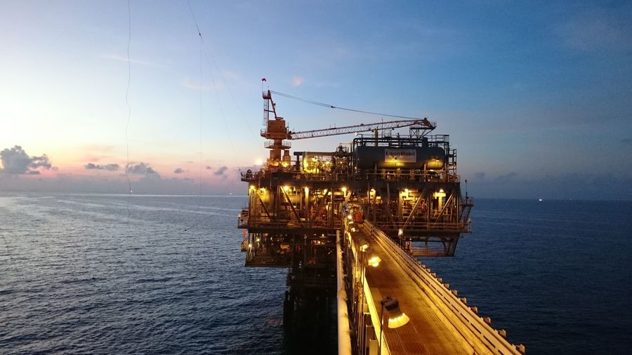 Platform sunrise Offshore Platform Fuel And Power Generation Oil Industry Sea Sunset Sky Water City Travel Destinations Outdoors Fossil Fuel Industry Built Structure No People Bridge - Man Made Structure Business Finance And Industry Drilling Rig Architecture Day