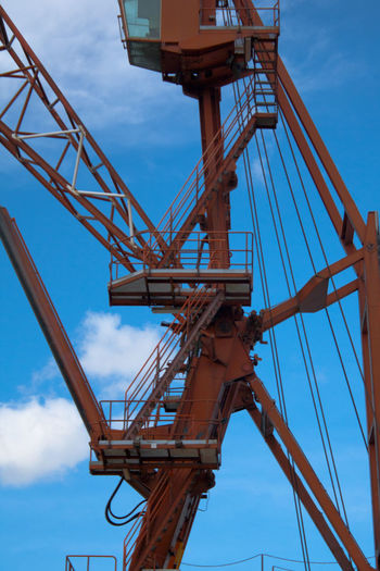Angles Blue Cable Cloud Connection Construction Construction Site Crane Crane - Construction Machinery Development Diagonals Engineering Industry Low Angle View Metal Platforms Red Sky Structure