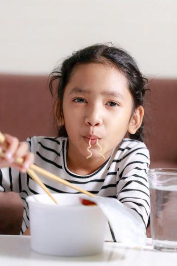 Portrait of girl having food