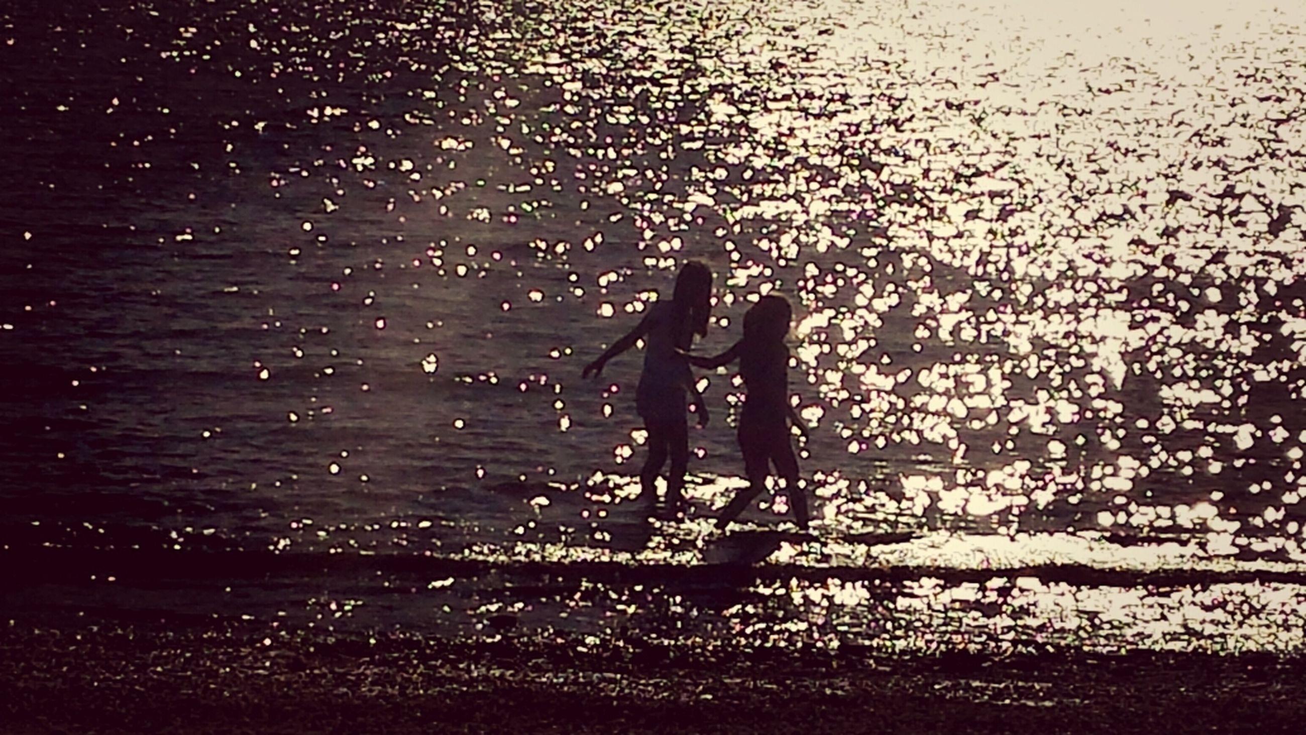 lifestyles, water, leisure activity, wet, rain, night, drop, season, standing, person, men, silhouette, weather, monsoon, full length, motion, indoors, illuminated