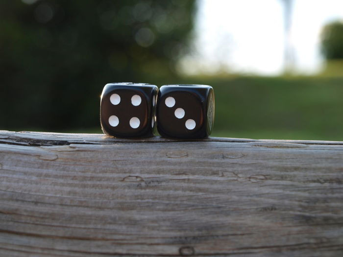 Close-up of dice on wooden table