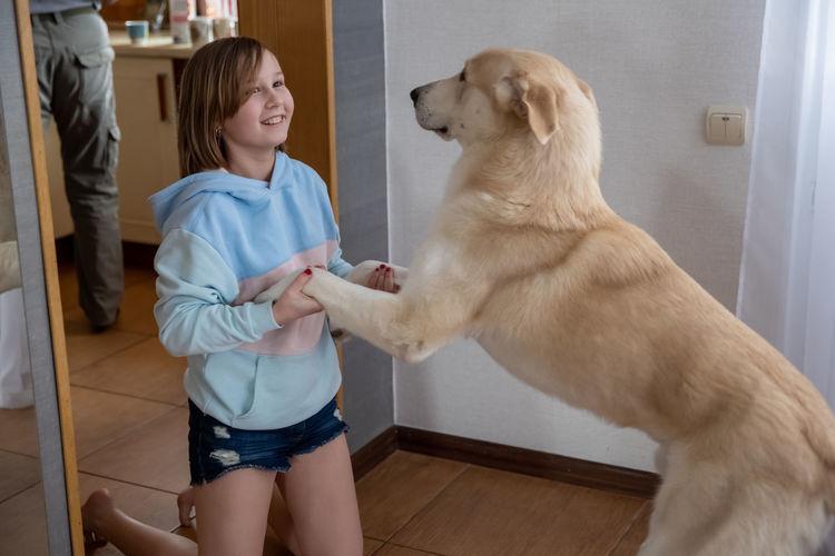 Full length of woman holding dog