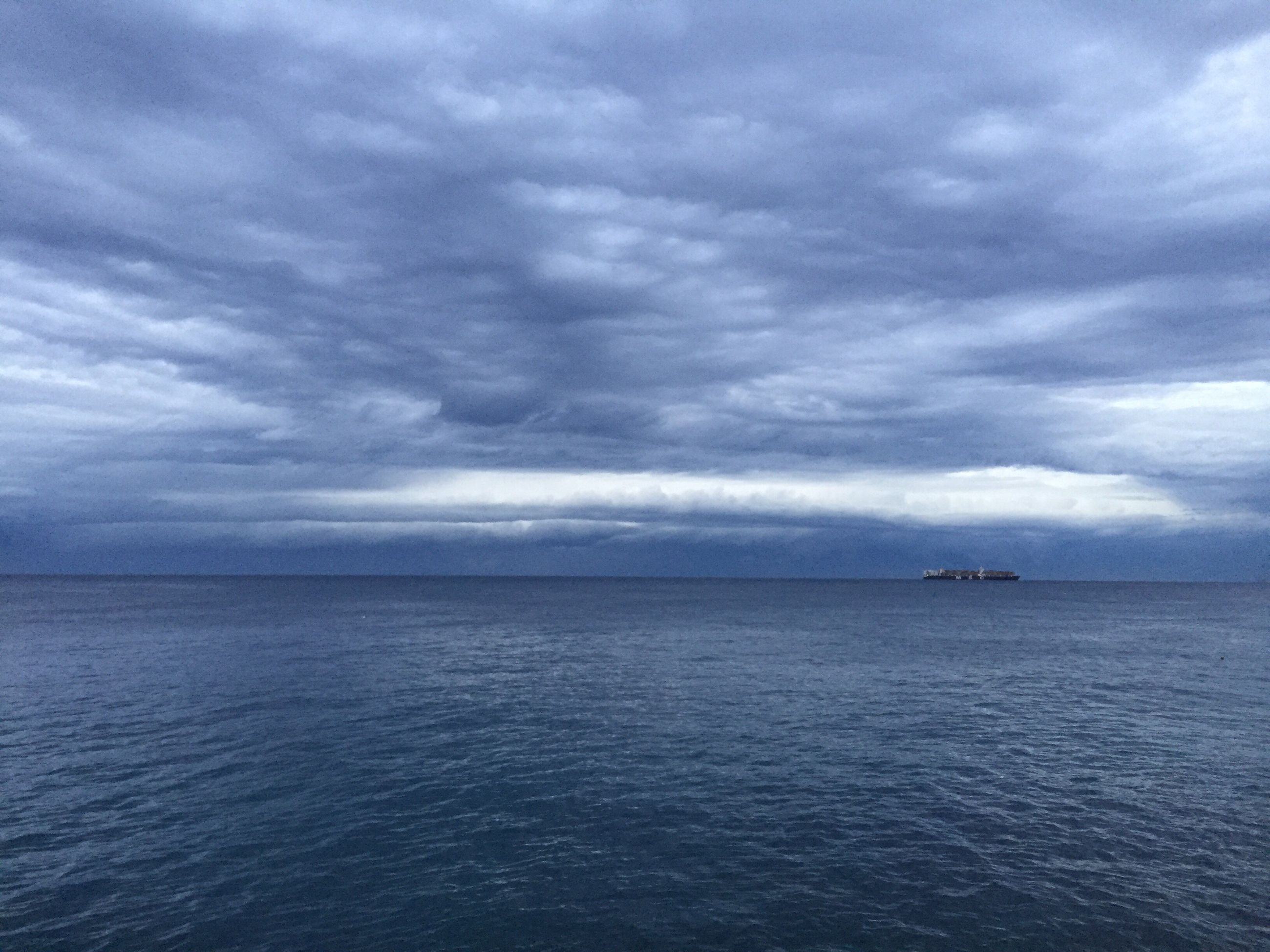 cloud - sky, sea, beauty in nature, sky, scenics, nature, horizon over water, tranquil scene, storm cloud, tranquility, overcast, weather, dramatic sky, outdoors, idyllic, no people, water, storm, landscape, thunderstorm, day