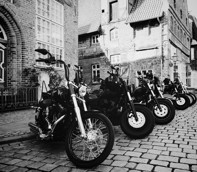 Harley Davidson Alireza Rezvani  Blackandwhite Photography Black And White Mode Of Transport Bicycle Parked Town City Life City Transportation Day Transportation Bicycle Mode Of Transport Land Vehicle Architecture Built Structure Stationary Building Exterior City Travel Street Parking City Life Full Length