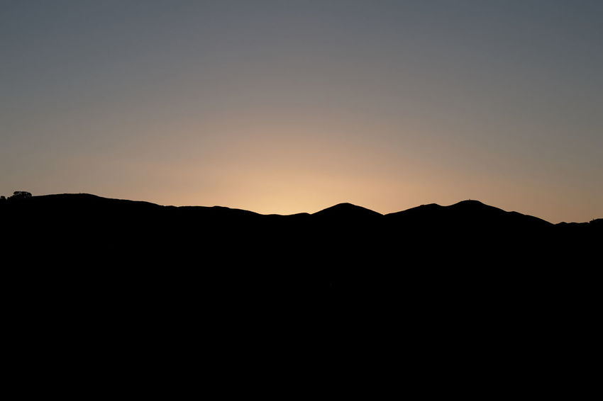 Beauty In Nature Clear Sky Copy Space Day Landscape Mountain Nature No People Outdoors Scenics Silhouette Sky Sunset Tranquil Scene Tranquility