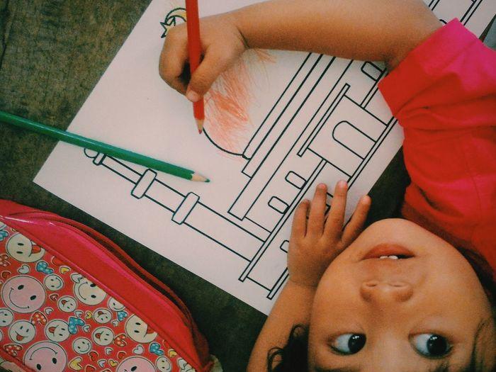 High angle view of girl drawing