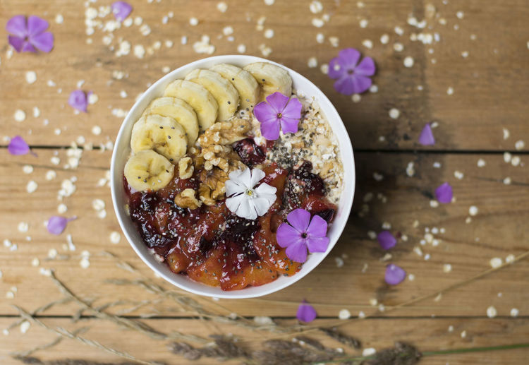 Breakfast bowl with fried plums, nuts and bananas. Banana Breakfast Bowl Close-up Flowers Food Food And Drink Foodphotography Gesund Healthy Healthy Eating No People Oats Plum Ready-to-eat Table Vegan