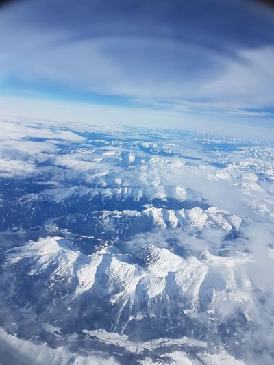 Blue Nature Cloud - Sky Aerial View Cold Temperature Beauty In Nature Sky No People Outdoors Day Snow Landscape Scenics Water Winter Backgrounds Cityscape Close-up Aircraft View Looking At The Horizon Nature Flying High Flying High Flying High