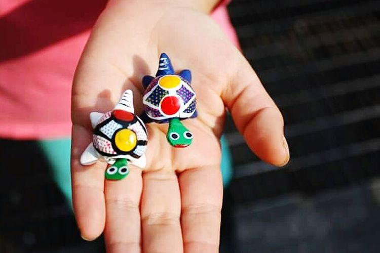 Human Hand Human Body Part Close-up People One Person Outdoors Day Toy Turtle Toy Colorful Mexican Toys