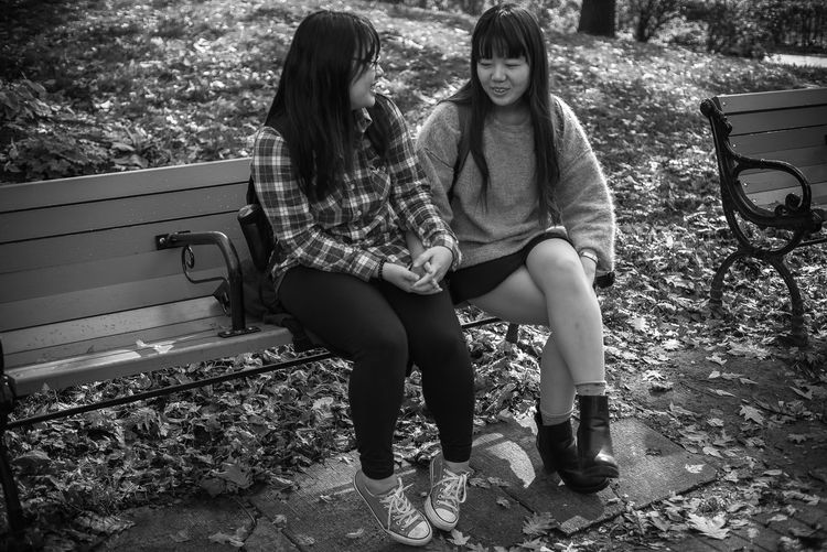 Autumn Park Bench Black And White Bonding Casual Clothing Day Documentary Friendship Full Length Leaves Leisure Activity Lifestyles Nature Outdoors Real People Sitting Streetphotography Togetherness Tree Two People Young Women Bnw_collection