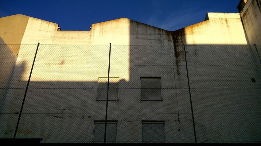 Back facade Day No People Low Angle View Outdoors Sky Building Exterior Architecture Lasuma Concrete Wall Street Urban Streetphotography Concrete Wall The City Light Creativity Madrid Texture And Surfaces Architecture Deterioration Backgrounds