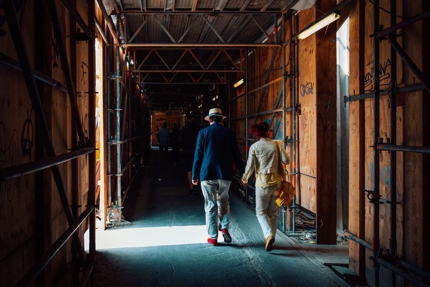 Classy couple. Architecture Building Built Structure Casual Clothing Construction Industry Construction Site Day Full Length Indoors  Industry Men Occupation One Person Real People Rear View Standing Walking Working