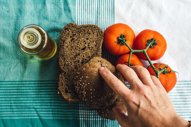 Olive oil, tomato and slides of brown bread on tablecloth Backgrounds Bakery Basketball Bowl Break Breakfast Cereals Closeup Cooking Farm Focus On Foreground Freshness Grany Healthy Ingredient Lifestyle Mediterranean  Natural Oil Organic Organic Food Rustic Rustic Style Table Tomato