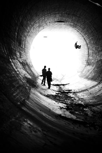 Silhouette Real People Tunnel Two People Leisure Activity Men Togetherness Lifestyles Day Sunlight Full Length Architecture Winter Outdoors Water Nature Adult Skate Skateboard Skateboarder Skateboarding EyeEmNewHere Black And White Friday