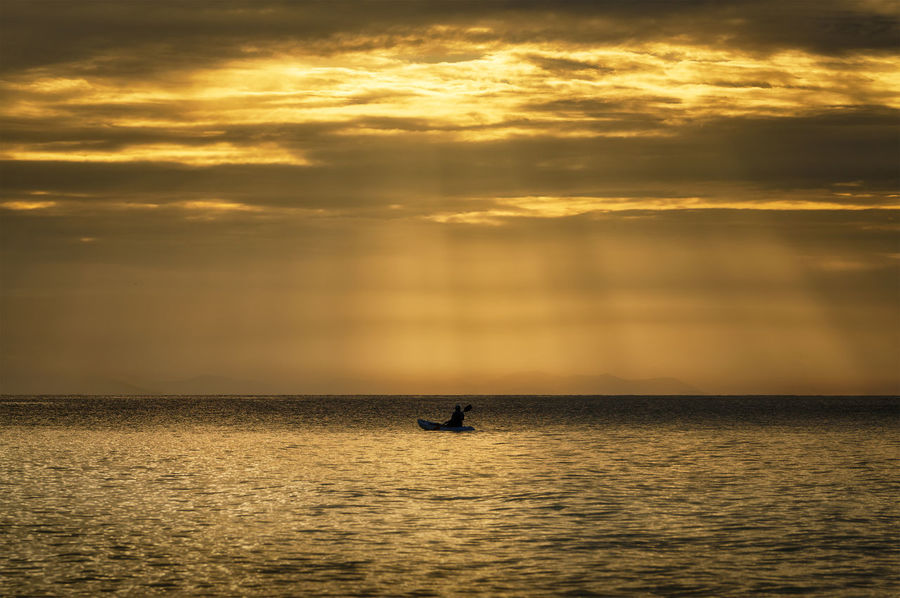 Alone Alone Beauty In Nature Boat Cloud - Sky Dramatic Sky Golden Hour Golden Sky Horizon Over Water Nature Ocean Rayong Samed Island Scenics Sea Silhouette Sunrays Sunset Thailand Tranquil Scene