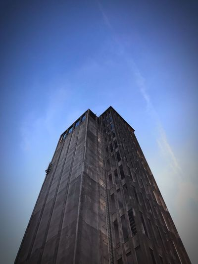 The Grey Tower 2 Low Angle View Sky Building Exterior Architecture Built Structure Building Tall - High No People City Tower Day Blue Outdoors Skyscraper Cloud - Sky Travel Destinations Sunlight Office Building Exterior Modern