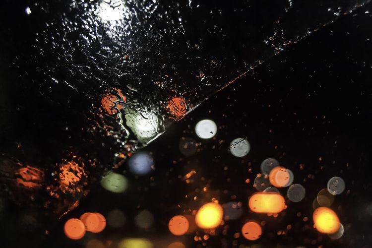 Car Lights Rain RainDrop Bokeh Bokeh Photography Car Car Window Close-up Dark Drop Glass - Material Illuminated Indoors  Light Nature Night No People Rain On Car Rain On Car Window Rain On Window RainDrop Rainy Season Selective Focus Water Wet