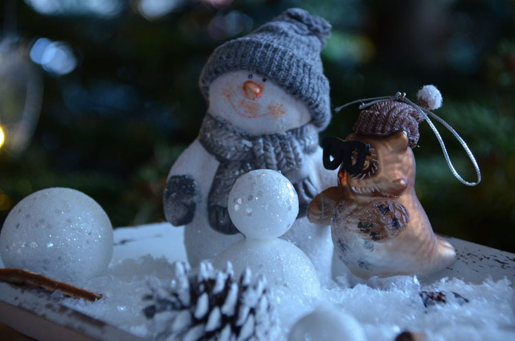 Christmas Schneemann Art And Craft Christmas Decoration Christmas Decorations Christmas Tree Christmastime Close-up Day Figurine  Focus On Foreground Human Representation Male Likeness No People Outdoors Sculpture Snowman Snowminimals Statue The Photojournalist - 2018 EyeEm Awards