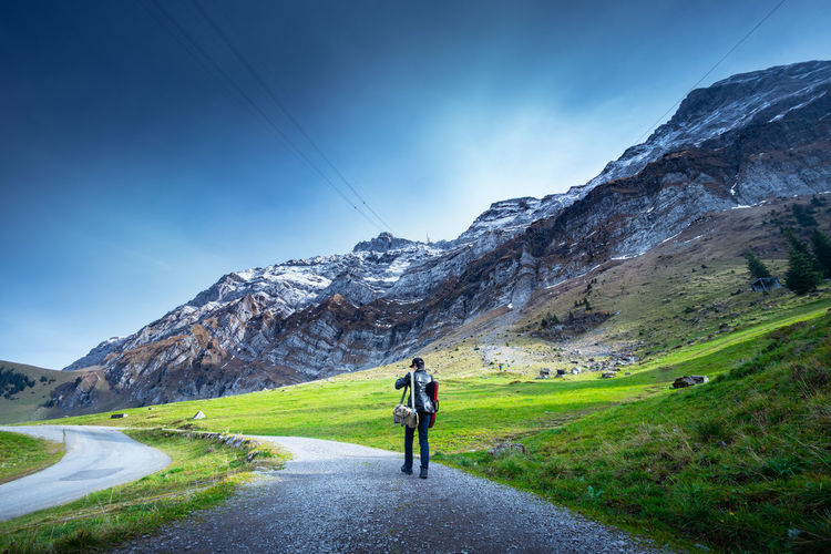 Mountain Real People Sky Beauty In Nature One Person Leisure Activity Rear View Scenics - Nature Day Lifestyles Road Nature Grass Non-urban Scene Full Length Mountain Range Tranquil Scene Transportation Environment Landscape Outdoors