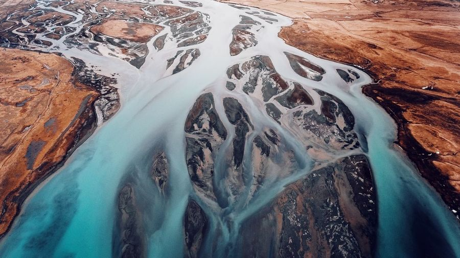 High angle view of water flowing over landscape
