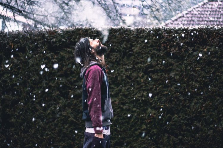 Man enjoying snow at yard