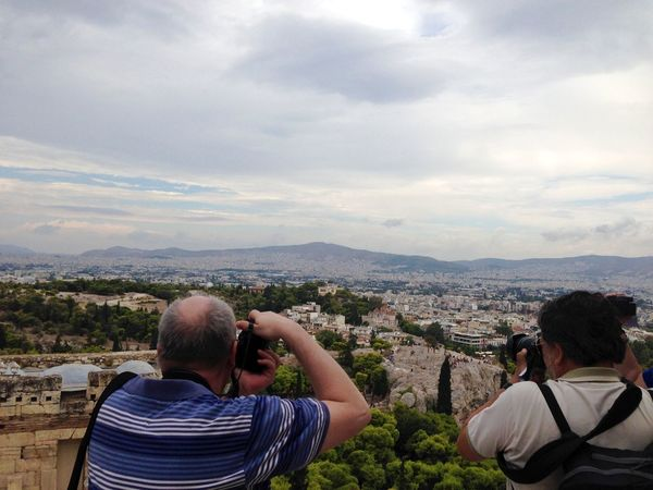 Two Men Paparazzi back turned looking into their photography cameras waiting to take the next great shot of a breathtaking landscape in Athens, Greece Back Turned Photographing Cloud - Sky Men Two People Photography Themes Camera - Photographic Equipment Mountain Tourism History Technology Day Casual Clothing Colour Your Horizn