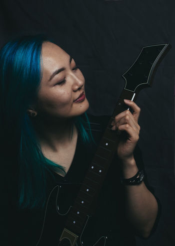 Music is my life. Asian  Asian Woman Blue Blue Hair Dark Eyes Closed  Feeling Good Guitar Guitar Hero Guitarist Holding Indoors  Korean Long Hair Music Music Is My Life One Woman Only Playing Playing Guitar Sensual Session Studio Shot Young Adult Young Woman The Portraitist - 2017 EyeEm Awards
