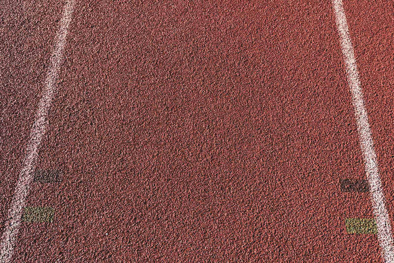 tartan track close up Tartan Track Athletics Sport Running Stadium Competition Speed Lanes Running Track Full Frame Textured  Track And Field No People Day Pattern Close-up Competitive Sport Sports Track Outdoors Brown Nature Red Playing Field High Angle View Dividing Line