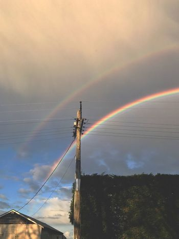 Rainbow Sky Cloud - Sky Scenics Nature Beauty In Nature Double Rainbow Sunset Low Angle View Outdoors No People Day Tree