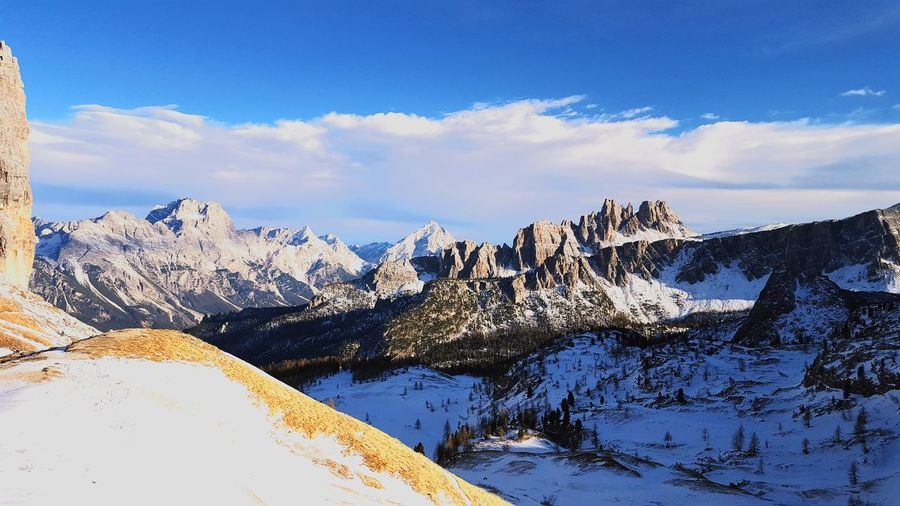 Rocky mountains against sky during winter at cortina d ampezzo