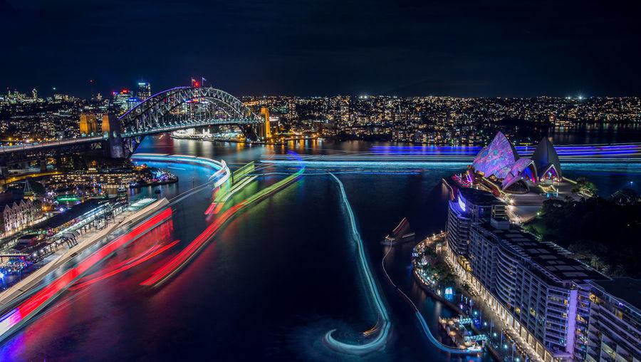 Sydney opera house and sydney harbor bridge at night
