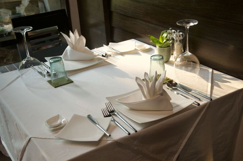 High angle view of glasses on table in restaurant