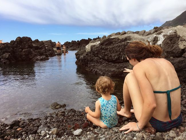 EyeEm Selects Togetherness Rock - Object Sitting Real People Two People Sky Water Shirtless Full Length Leisure Activity Childhood Day Beach Sand Outdoors Boys Lifestyles Nature Sea Bonding Azores Fajal Island Flores Island Portugal