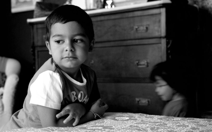 The Portraitist - 2017 EyeEm Awards Childhood Real People Indoors  Innocence Waist Up Boys Elementary Age Looking At Camera Home Interior Sitting Portrait Cute Two People Lifestyles Girls Togetherness Leisure Activity Day Close-up People Blackandwhite Black & White Blackandwhite Photography Brothers