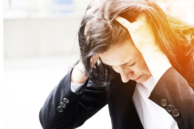Stressed businesswoman with hands in hair