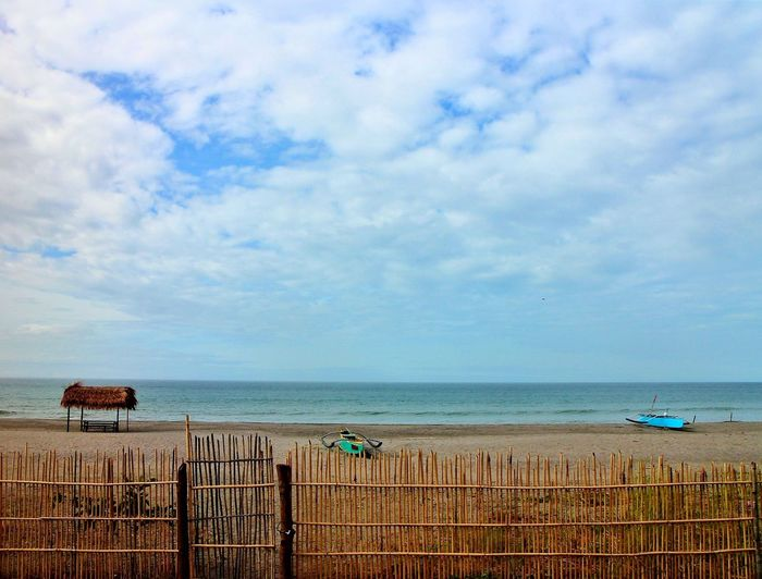 just behind the fence Sea Beach Water Nature Sky Landscape Tree Blue Shadow Sunlight Outdoors Tranquility Sand Philippines Scenics Beauty In Nature Iba Zambales Zambales Fence
