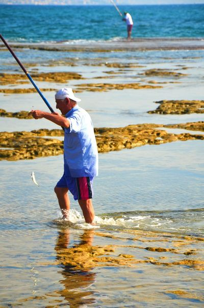 Byblos Byblos,Lebanon Casual Clothing Catch Day Enjoyment Fish Fisherman Fishermen's Life Fishing Fun Leisure Activity Lifestyles Nature Outdoors Shore Tranquility Water