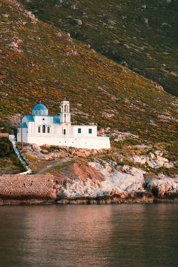 Church building on mountain by sea