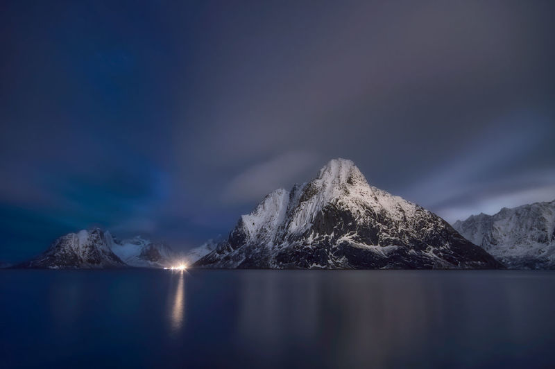 Scenic view of snowcapped mountains against sky during winter norway.
