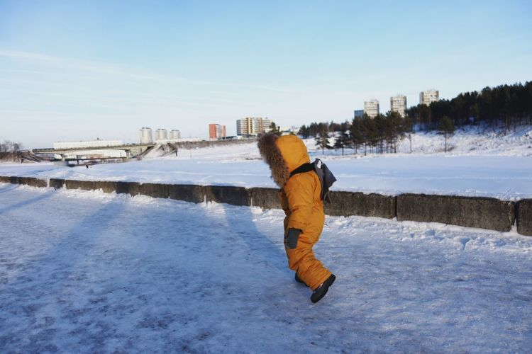 Urban Urban Skyline #siberia Boy Kid Babyboy Baby Photography Orange Color Boyscanfly Warm Clothing Water Snow Cold Temperature Full Length Winter City Rear View Walking Tranquil Scene Scenics