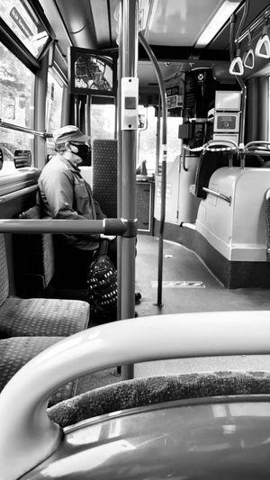 Full length of man sitting in bus