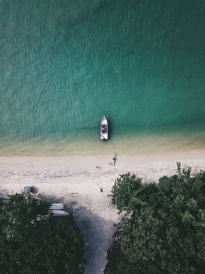 High angle view of boat at beach against sea