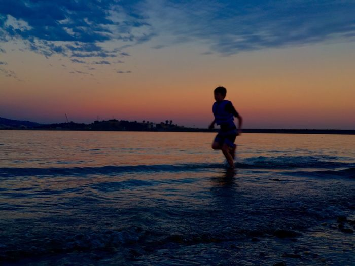 Boy running on the beach The Great Outdoors - 2016 EyeEm Awards The Essence Of Summer